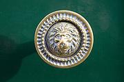 Brass face head lion door knob, Devizes, Wiltshire, England, UK
