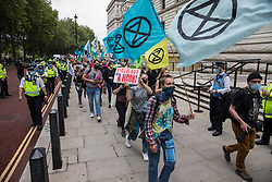 Climate activists from Extinction Rebellion attend a 'Carnival of Corruption' protest against the government's facilitation and funding of the fossil fuel industry on 3 September 2020 in London, United Kingdom. Extinction Rebellion activists are attending a series of September Rebellion protests around the UK to call on politicians to back the Climate and Ecological Emergency Bill (CEE Bill) which requires, among other measures, a serious plan to deal with the UK's share of emissions and to halt critical rises in global temperatures and for ordinary people to be involved in future environmental planning by means of a Citizens' Assembly.