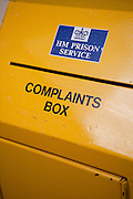 A yellow prioner compliants box. HMP/YOI Askham Grange is a women's open prison serving the Yorkshire area with a capacity of 128 women. It has extensive education, training and mother and Baby facilities.