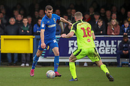 AFC Wimbledon attacker Adam Roscrow (10) taking on Bolton Wanderers midfielder Ethan Hamilton (18) during the EFL Sky Bet League 1 match between AFC Wimbledon and Bolton Wanderers at the Cherry Red Records Stadium, Kingston, England on 7 March 2020.