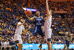 Dec 1, 2019; Morgantown, WV, USA; Rhode Island Rams guard Fatts Russell (1) shoots during the first half against the West Virginia Mountaineers at WVU Coliseum. Mandatory Credit: Ben Queen-USA TODAY Sports