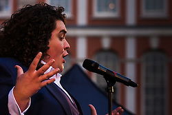 Covent Garden, London, October 30th 2014. They Royal British Legion's Poppy Day in London centred around Covent Garden where bands, choirs, classical and pop musicians entertained crowds as Air Force personnel carrying donation buckets sold poppies, hoping to raise in excess of £1 million. Pictured: Tenor Jonathan Antoine entertains the crowd in Covent Garden.