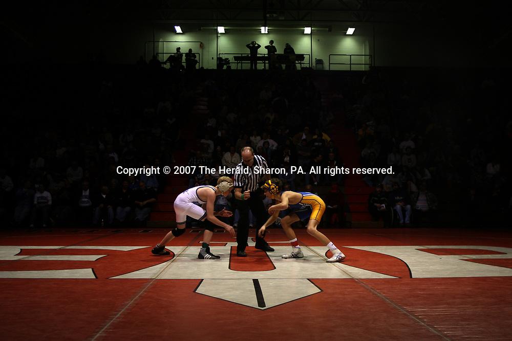 Reynolds' Rodney Harnett and Greenville's Luke Marshall prepare to square off at the PIAA District 10 Wrestling Team Dual Championship meet in Edinboro, Pa.