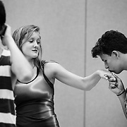 Musical Theatre Production student Jeremy Ivory-Chambers, 15, of California, places a impromptu kiss on the hand of Abby Tucker, 15, of Alabama, during a rehearsal at Interlochen Center for the Arts in Interlochen, Michigan.
