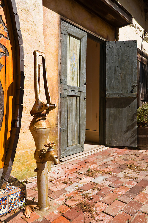 Old water pump and wooden doors at the Harmony Chapel, Harmony, California