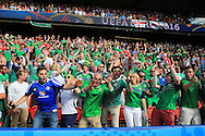 Northern Ireland fans sing and dance. UEFA Euro 2016, last 16 , Wales v Northern Ireland at the Parc des Princes in Paris, France on Saturday 25th June 2016, pic by  Andrew Orchard, Andrew Orchard sports photography.