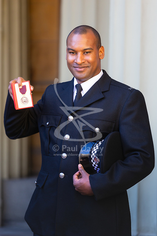 London Bridge Terror attack hero Constable Wayne Marques displays his George Medal received at an investiture by Her Majesty The Queen at Buckingham Palace in London. London, October 11 2018.