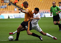 Photo: Rich Eaton.<br /> <br /> Wolverhampton Wanderers v Luton Town. Coca Cola Championship. 26/08/2006. Carlos Edwards right of luton tackles Daniel Jones of Wolves