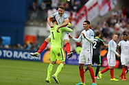 Gary Cahill of England celebrates with England goalkeeper Joe Hart at the end of the match, Euro 2016, group B , England v Wales at Stade Bollaert -Delelis  in Lens, France on Thursday 16th June 2016, pic by  Andrew Orchard, Andrew Orchard sports photography.