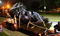 August 16, 2017 - Baltimore, MD, USA - A monument dedicated to the Confederate Women of Maryland lies on a flatbed trailer near the intersection of Charles St. and University Parkway early Wednesday morning after it was taken down. (Credit Image: © Jerry Jackson/TNS via ZUMA Wire)