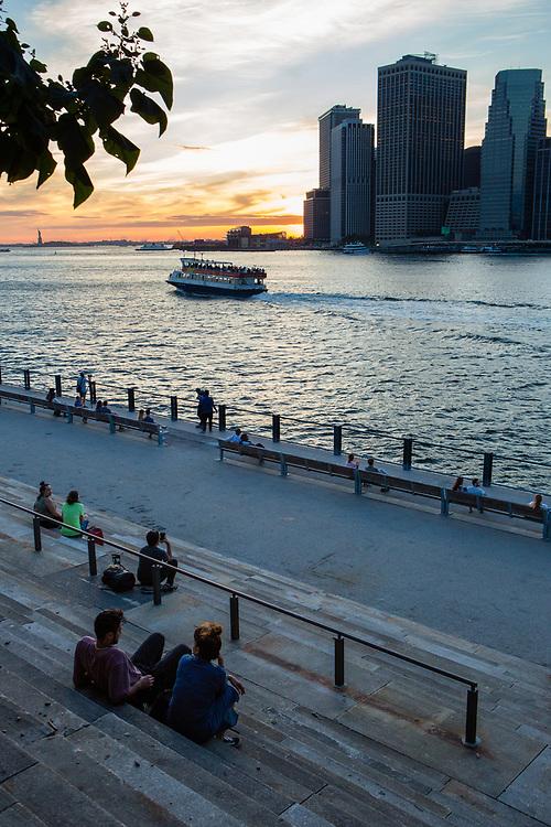 Sunset over the skyline of lower Manhattan, seen from the Granite Prospect of Brooklyn Bridge Paark.