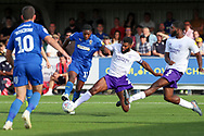 AFC Wimbledon attacker Michael Folivi (17) tries to shoot but Shrewsbury Town defender Aaron Pierre (2) tackles during the EFL Sky Bet League 1 match between AFC Wimbledon and Shrewsbury Town at the Cherry Red Records Stadium, Kingston, England on 14 September 2019.