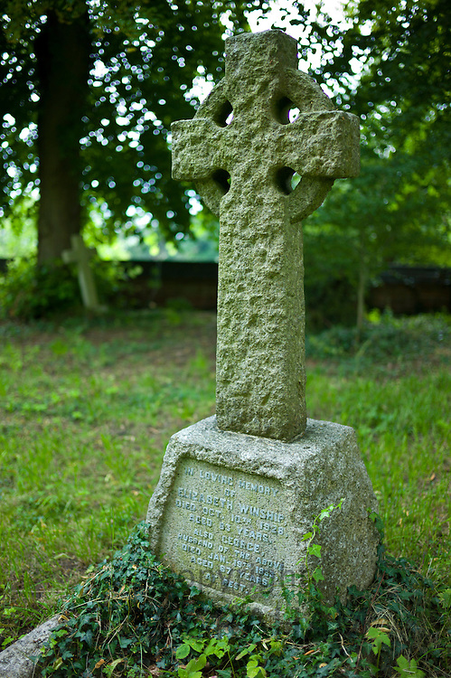 Celtic cross grave for Elizabeth and George Winship in graveyard of St Mary the Virgin Church, Harefield, Middlesex, UK