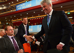 © Licensed to London News Pictures. 09/10/2012. Birmingham, UK © Jeremy Hunt the Secretary of State for Health shakes hands with former Health Secretary Andrew Lansley at The Conservative Party Conference at the ICC today 9th October 2012. Photo credit : Stephen Simpson/LNP