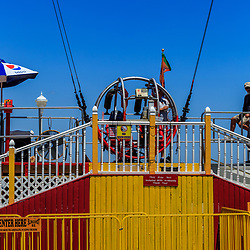 Ocean City, MD, USA - May 26, 2018: The Slingshot is an amusement ride on the boardwalk that bounces riders high into the air.