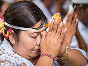 19 JULY 2016 - TAMPAKSIRING, GIANYAR, BALI, INDONESIA: Women pray on the first day of a ceremony to honor the anniversary Pura Agung temple, one of the most important Hindu temples on Bali. This year's ceremony is the most important in years because it falls on the 50 year cycle of the temple's founding. This year's ceremony lasts for 11 days.      PHOTO BY JACK KURTZ