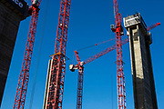 Red cranes at a Mace construction site, Broadgate in Liverpool Street, London, United Kingdom.