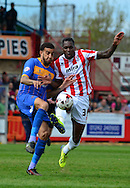Connor Goldson an Mathieu Manset battle for the ball during the Sky Bet League 2 match between Cheltenham Town and Shrewsbury Town at Whaddon Road, Cheltenham, England on 25 April 2015. Photo by Alan Franklin.
