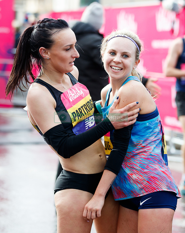 The winner of the women's race Charlotte Purdue (right) is congratulated by second placed Lily Partridge during the Vitality Big Half in London City Centre.