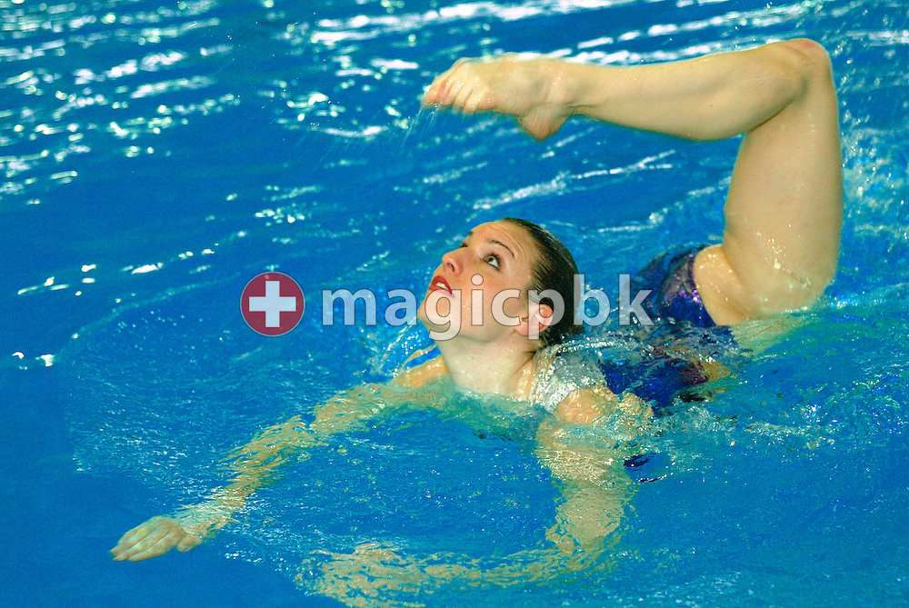 Swiss synchronized swimmer Belinda Schmid is pictured during a photo session at Hallenbad Oerlikon in Zurich, Switzerland, Sunday 22 December 2002. (Photo by Patrick B. Kraemer / MAGICPBK)