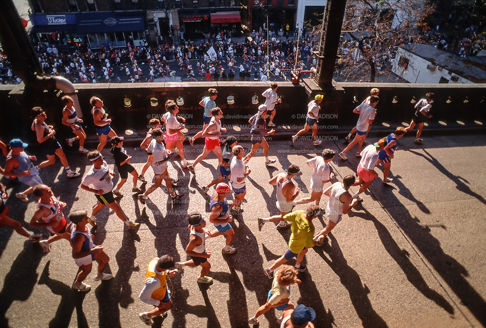 NEW YORK - NOVEMBER 3:  Runners competing in the 1991 New York City Marathon cross the Queensboro Bridge into Manhattan near the midway point of the race on November 3, 1991 in New York, New York.  (Photo by David Madison/Getty Images)