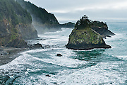 Drive to Arch Rock Picnic Area on US Route 101 and walk the Oregon Coast Trail to see the Pacific Ocean crashing on cliffs, along Samuel H. Boardman State Scenic Corridor, Curry County, Oregon, USA.