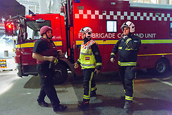 June 4, 2017 - London, London, UK - LONDON, UK.  A fire Brigade Control Unit and officers arrives in a road south of Borough Market and London Bridge.  A van and knife attack have been reported to have taken place on London Bridge this evening and also a further incident at Borough Market. (Credit Image: © Vickie Flores/London News Pictures via ZUMA Wire)