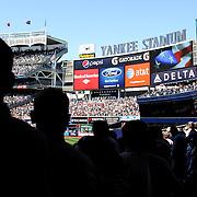 Fans sing 'God Bless America' during the New York Yankees V Cincinnati Reds Baseball game at Yankee Stadium, The Bronx, New York. 19th May 2012. Photo Tim Clayton
