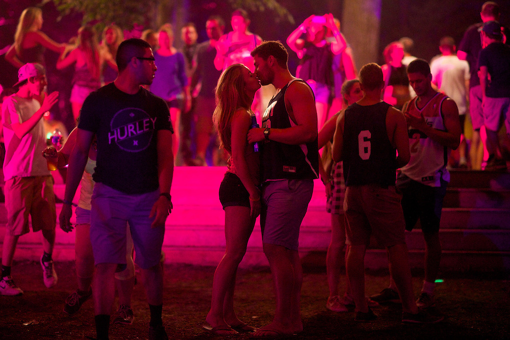 A couple kisses during the Firefly Music Festival in Dover, DE on June 21, 2014.  The four day festival is set at a 105 acre grounds at the Dover International Speedway and many well known bands perform.