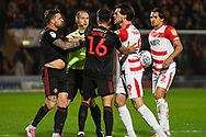 Tempers flare between Chris Maguire of Sunderland (7) and John Marquis of Doncaster Rovers (9) after a mould from Reece James of Sunderland (16) during the EFL Sky Bet League 1 match between Doncaster Rovers and Sunderland at the Keepmoat Stadium, Doncaster, England on 23 October 2018.