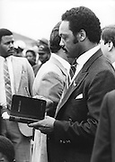 Reverend Jesse Jackson autographs a supporters Bible as he campaigns across the south in his 1984 bid to be the first African American president of the United States.