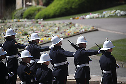 Members of the Royal Marines line the route of the procession at Windsor Castle, Berkshire, ahead of the funeral of the Duke of Edinburgh. Picture date: Saturday April 17, 2021.
