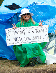 © London News Pictures. 17/08/2013. Balcombe, UK. A Campaigner holding a sign  at the entrance tot the Cuadrilla drilling site in Balcombe, West Sussex which has been earmarked for fracking. Cuadrilla has temporarily ceased drilling at the site under advice from the police after campaign group No Dash For Gas threatened a weekend of civil disobedience. Photo credit: Ben Cawthra/LNP