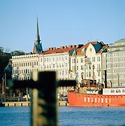 Red boat in Helsinki harbor, Finland.