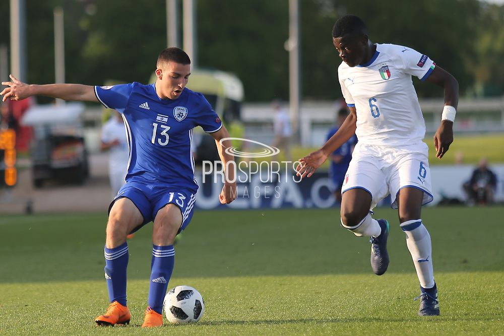 Osher Davida of Israel (13) and Paolo Gozzi Iweru of Italy (6) during the UEFA European Under 17 Championship 2018 match between Israel and Italy at St George's Park National Football Centre, Burton-Upon-Trent, United Kingdom on 10 May 2018. Picture by Mick Haynes.