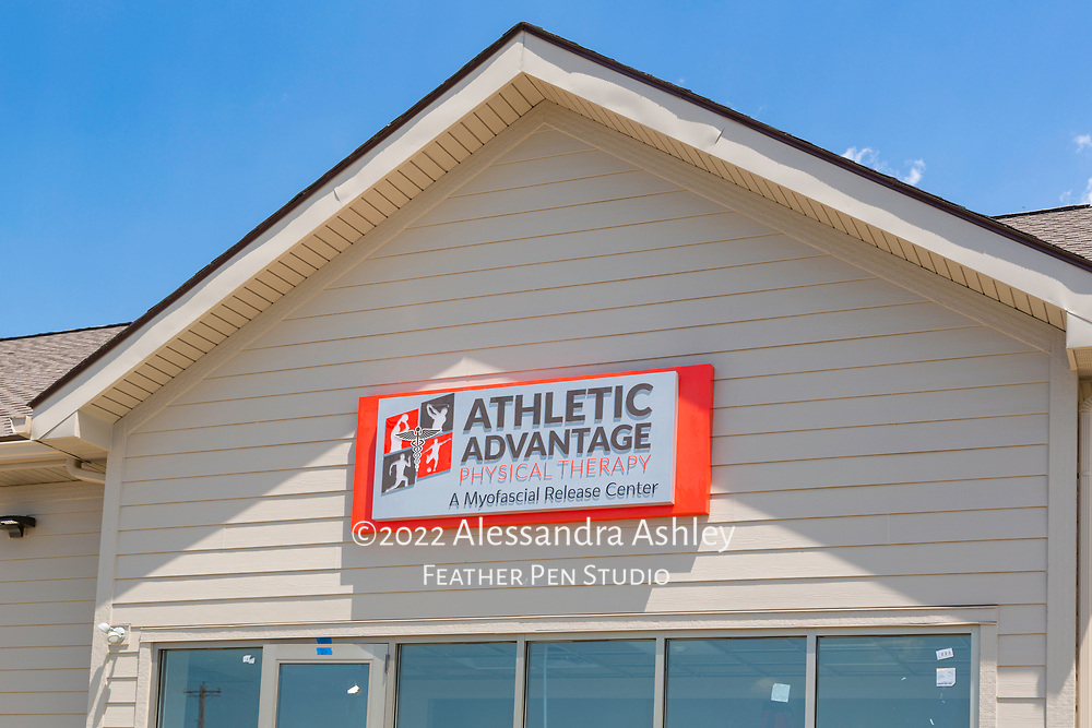 New sign installed on building facade at new physical therapy and wellness center.