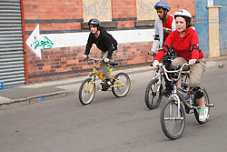 Young people on bikes.