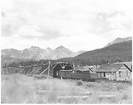View looking NE of RGS snowshed and section house at Lizard Head.  An outfit box car and gondola are on the siding.<br /> RGS  Lizard Head, CO  ca. ? 1952<br /> RD137-096 and RD137-097 may be companion photos.<br /> Thanks to Don Bergman for additional information.