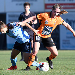 BRISBANE, AUSTRALIA - OCTOBER 30: Maddy Evans of the roar tackles Servet Uzunlar of Sydney during the round 1 Westfield W-League match between the Brisbane Roar and Sydney FC at Spencer Park on November 5, 2016 in Brisbane, Australia. (Photo by Patrick Kearney/Brisbane Roar)