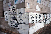 Egypt, Cairo 2014. Stencilled faces of martrys on street corner.