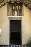 A doorway in the Chiesa Santa Maria Di Castello, Genoa, Italy. The church, in Romanesque style, was erected before 900 AD. It houses many artworks commissioned by the main noble families of Genoa and is flanked by the large Tower of the Embriaci.