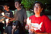 """Sept. 19 - PHOENIX, AZ: Families in support of the DREAM Act at a candlelight vigil in front of Sen. John McCain's office in Phoenix Sunday night. About 30 people met in front of US Sen. John McCain's office in Phoenix Sunday night to demonstrate in support of the DREAM Act, which is scheduled to be debated in the US Senate on Tuesday, Sept 21. The Development, Relief and Education for Alien Minors Act (The """"DREAM Act"""") is a piece of proposed federal legislation in the United States that was introduced in the United States Senate, and the United States House of Representatives on March 26, 2009. This bill would provide certain illegal immigrant students who graduate from US high schools, who are of good moral character, arrived in the U.S. as minors, and have been in the country continuously for at least five years prior to the bill's enactment, the opportunity to earn conditional permanent residency. In the early part of this decade McCain supported legislation similar to the DREAM Act, but his position on immigration has hardened in the last two years and he no longer supports it. The protesters, mostly area students, marched and drilled to show their support for the US military and then held a candle light vigil.   Photo by Jack Kurtz"""
