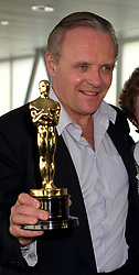 File photo dated 2/4/1992 of Anthony Hopkins holds the Academy Award Oscar he received for his role as Hannibal Lecter, in the film The Silence of the Lambs, as he arrives at Heathrow airport, London, with his wife Jenny. Sir Anthony Hopkins has been named as best actor at the 2021 Oscars for his role as a man slipping into dementia in The Father. Issue date: Monday April 26, 2021.