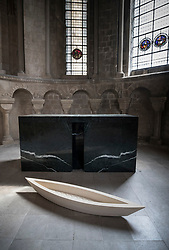 © Licensed to London News Pictures. 24/05/2018. Canterbury, UK.  Baldwin & Guggisberg's sculpture 'The Stone Boat, 2018' is displayed in St Anselm's Chapel at Canterbury Cathedral. A series of glass installations by artists Philip Baldwin and Monica Guggisberg reflecting on themes of war and remembrance, migration and refugees are going on display at the cathedral commemorating the 100th anniversary of the end of the First World War. Under an Equal Sky will take visitors on a journey that begins with the Boat of Remembrance in the Nave and ends with a glass wall of multi-coloured vessels in The Crypt . Photo credit: Peter Macdiarmid/LNP