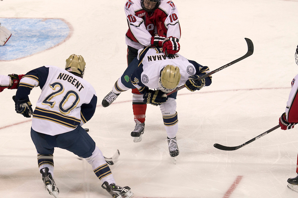 RPI defenseman Curtis Leonard (#10) checks Notre Dame center Riley Sheahan (#4) in second period action of NCAA hockey game between Notre Dame and Rensselaer Polytechnic Institute (RPI).  The Notre Dame Fighting Irish defeated Rensselaer Polytechnic Institute (RPI) Engineers 5-2 in game at the Compton Family Ice Arena in South Bend, Indiana.