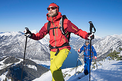 Skiers walking on snowy mountain