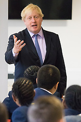 Michaela Community School, Wembley, London, June 23rd 2015. Mayor of London Boris Johnson visits the Michaela Community School, a Free School in Wembley that started taking students in September2014 after battling a certain amount of resistance from locals and unions. During the visit Head Teacher Katharine Birbalsingh took the Mayor on a tour of the school before he participated in a history lesson, prior to sitting down with pupils for brunch. PICTURED: Boris Johnson answers pupils questions during a Q&A session after brunch.