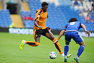 Dominic Iorfa of Wolverhampton Wanderers goes past Cardiff's Fabio Da Silva. Skybet football league championship match, Cardiff city v Wolverhampton Wanderers at the Cardiff city stadium in Cardiff, South Wales on Saturday 22nd August 2015.<br /> pic by Andrew Orchard, Andrew Orchard sports photography.
