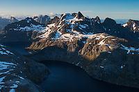 View over Fjerddalsvatnet lake towards Munken and surrounding mountains, Moskenesøy, Lofoten Islands, Norway