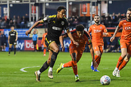 AFC Wimbledon Defender Toby Sibbick (20) and Luton Town Defender James Justin (2) battle for the ball during the EFL Sky Bet League 1 match between Luton Town and AFC Wimbledon at Kenilworth Road, Luton, England on 23 April 2019.